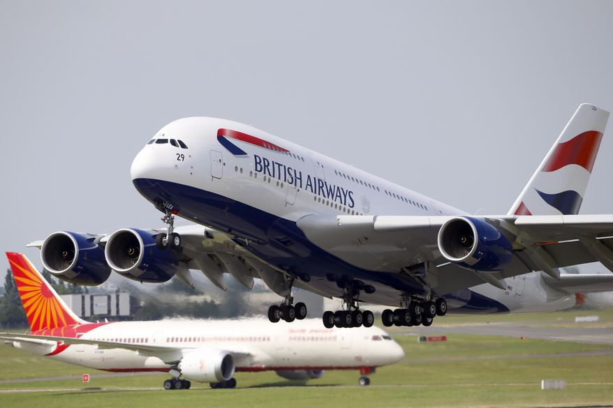A British Airways Airbus A380 (right) takes off in front of an Air India Boeing 787 Dreamliner during the first day of the 50th Paris Air Show at Le Bourget Airport, north of Paris, on Monday, June 17, 2013. (AP Photo/Francois Mori)
