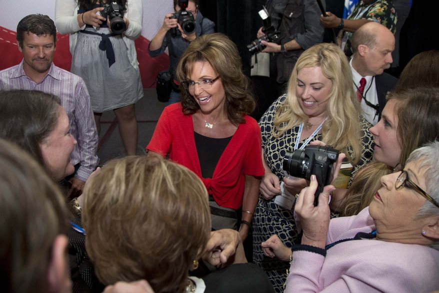 ** FILE ** Former Gov. of Alaska Sarah Palin, with her husband Todd Palin, top left, greets supporters after speaking at the Faith and Freedom Coalition Road to Majority 2013 conference, Saturday, June 15, 2013, in Washington. (AP Photo/Carolyn Kaster)