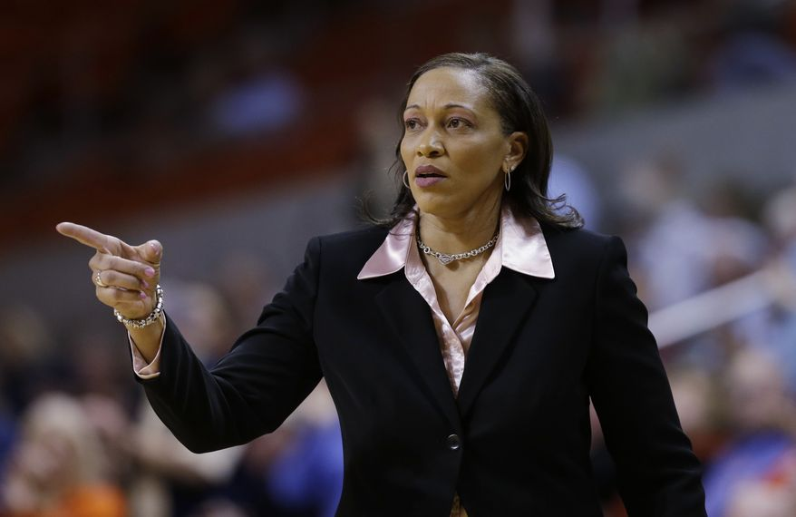 **FILE** In this March 27, 2013, file photo, Auburn head coach Terri Williams-Flournoy directs her team during the second half of an NIT tournament basketball game against Tulane in Auburn, Ala. The former Georgetown coach led the Tigers to a 19-15 record in her first season. Now, she will have seven newcomers in her first full year of recruiting to join three returning starters led by second-team All-Southeastern Conference pick Hasina Muhammad at guard. (AP Photo/Dave Martin, File)
