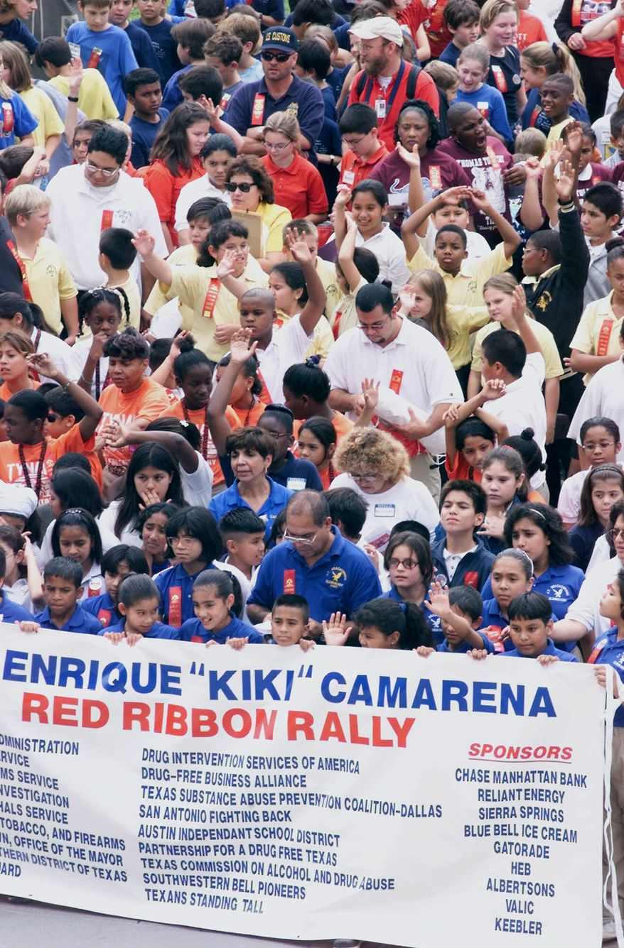 """**FILE** Some of the more than 500 Texas fifth- and sixth-grade students are shown during a red-ribbon rally against drug use at the Capitol in Austin on Oct. 19, 2000. Celebrating national Drug Prevention Month, the event also honors the memory of Drug Enforcement Administration agent Enrique """"Kiki"""" Camarena, who was murdered by drug dealers in Mexico in 1985. (Associated Press)"""