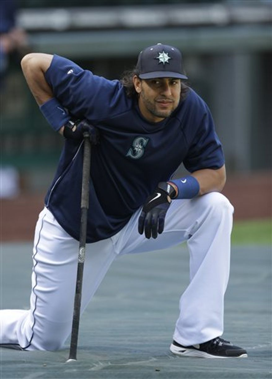 Seattle Mariners' Michael Morse rests during batting practice before a baseball game against the Houston Astros, Wednesday, June 12, 2013, in Seattle. (AP Photo/Ted S. Warren)