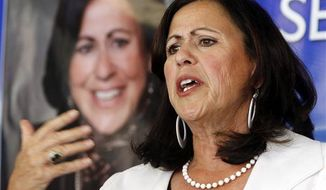 ** FILE ** Colorado state Sen. Angela Giron, Pueblo Democrat, speaks about the attempt to recall her during a news conference at the Colorado Democratic Party headquarters in Denver on Monday, June 10, 2013. (AP Photo/Ed Andrieski)