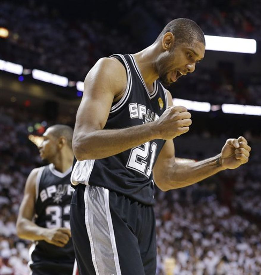 San Antonio Spurs power forward Tim Duncan (21) reacts to play against the Miami Heat during the second half of Game 6 of the NBA Finals basketball game, Tuesday, June 18, 2013 in Miami. (AP Photo/Lynne Sladky)