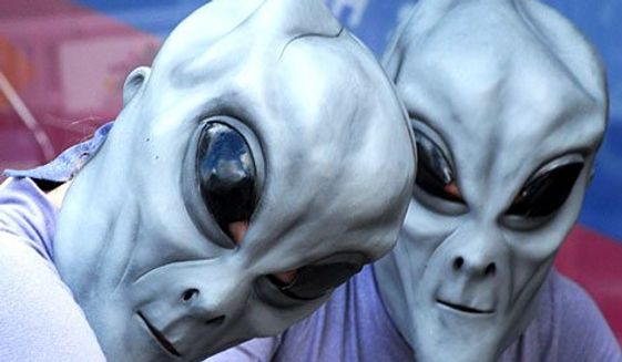 Citizens attend the Roswell, N.M. annual UFO convention. (Associated Press) **FILE