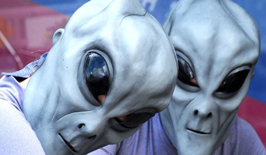** FILE ** Citizens attend the Roswell, N.M. annual UFO convention. (Associated Press)