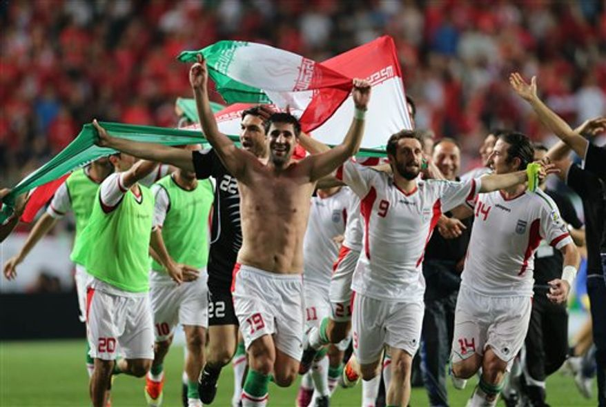 Iran players celebrate after beating South Korea during the Asian zone Group A qualifying soccer match for the 2014 World Cup in Ulsan, South Korea Tuesday, June 18, 2013. Iran won 1-0. (AP Photo/Yonhap, Kim Do-hun)