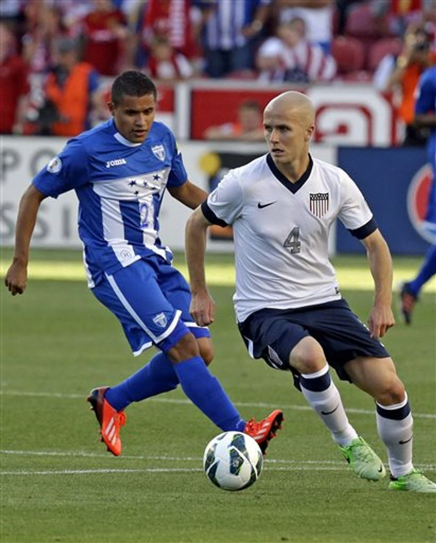 Honduras' Roger Rojas (21) defends against United States' Michael Bradley (4) in the first half during a World Cup qualifying soccer match at Rio Tinto Stadium on Tuesday, June 18, 2013, in Sandy, Utah. (AP Photo/Rick Bowmer)