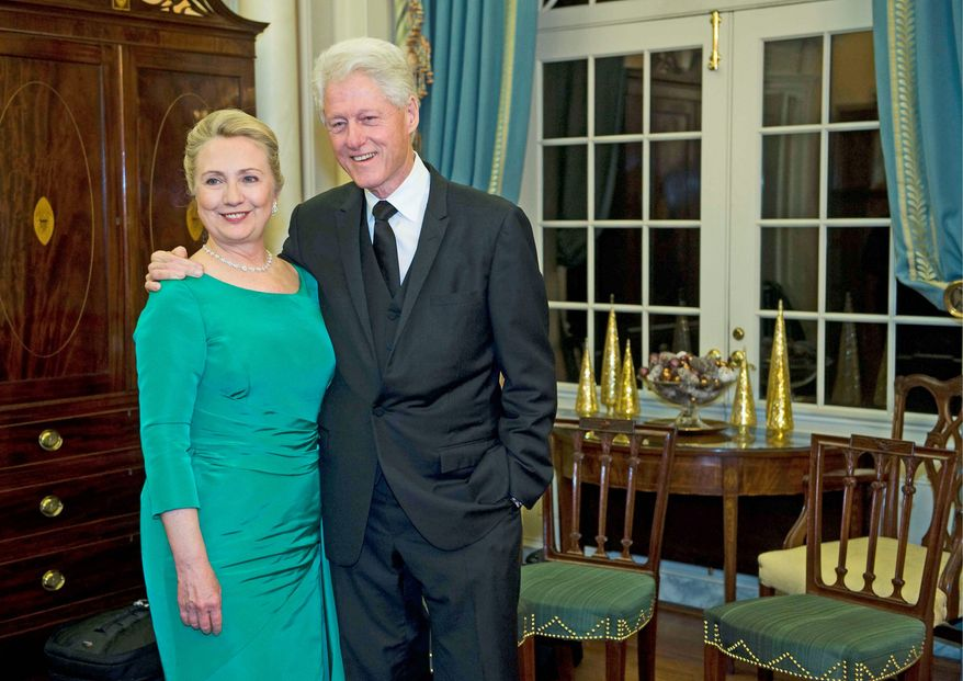"""If Hillary Rodham Clinton wants to run a successful campaign for president, she """"needs not only to manage expectations but also to show she can manage her husband,"""" according to Bloomberg News columnist Margaret Carlson. (Associated Press)"""
