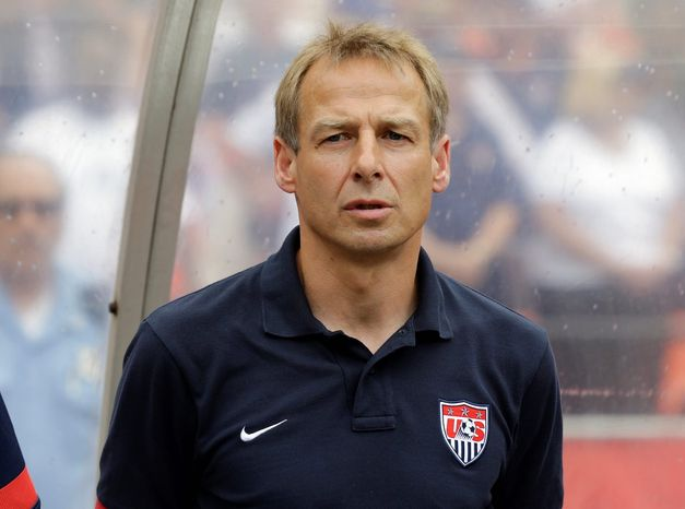 U.S. head coach Jurgen Klinsmann stands for the National Anthem before an international friendly soccer match at RFK Stadium Sunday, June 2, 2013, in Washington. (AP Photo/Alex Brandon)
