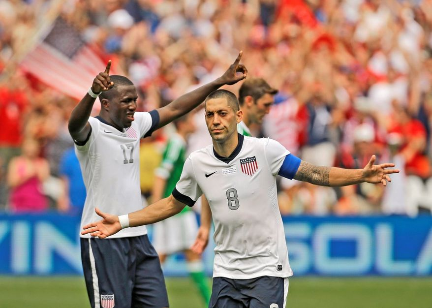 U.S. forward Clint Dempsey (8) celebrates his second goal with forward Jozy Altidore (17) during the second half of an international friendly soccer match against Germany at RFK Stadium Sunday, June 2, 2013, in Washington. The U.S. won 4-3. (AP Photo/Alex Brandon)