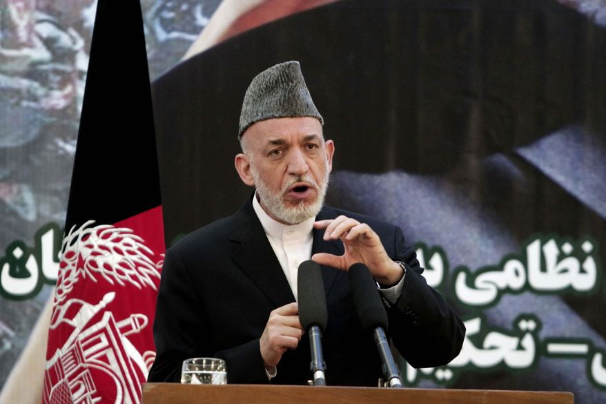 ** FILE ** Afghan President Hamid Karzai speaks at a press conference during a ceremony at a military academy on the outskirts of Kabul, Afghanistan, Tuesday, June 18, 2013. (AP Photo/Rahmat Gul)