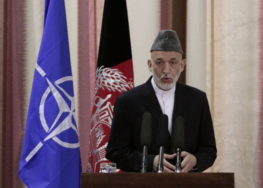 Afghan President Hamid Karzai speaks during a ceremony at military academy on the outskirts of Kabul, Afghanistan, on Tuesday, June 18, 2013. Mr. Karzai announced at the event that his country's armed forces are taking over the lead for security nationwide from the U.S.-led NATO coalition. (AP Photo/Rahmat Gul)