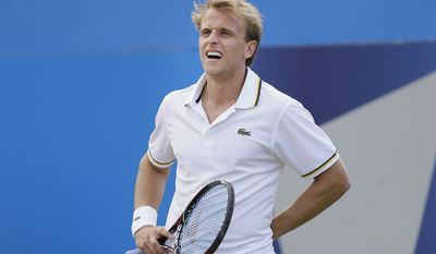 Denis Kudla of the US reacts to a line call as he plays Jo-Wilfried Tsonga of France during their quarterfinal tennis match at the Queens Club grass court championships in London, Friday, June 14, 2013. (AP Photo/Alastair Grant)