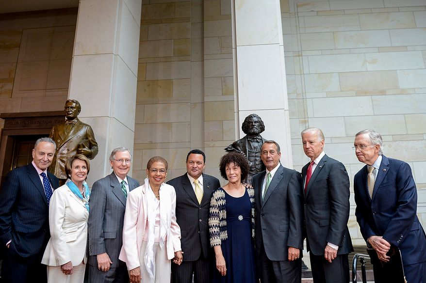 Left to right: Sen. Chuck Schumer (D-N.Y.), House Minority Leader Nancy Pelosi (D-Calif.), Senate Minority Leader Mitch McConnell (R-Ky.), Delegate Eleanor Holmes Norton (D-D.C.), the great great-great-great grandson of Frederick Douglass Kenneth B. Morris, Jr., the great great granddaughter of Frederick Douglass Nettie Washington Douglass, Speaker of the House John Boehner (R-Ohio), U.S. Vice President Joe Biden and Senate Majority Leader Harry Reid (D-Nev.) pose together at a congressional ceremony to commemorate the dedication and unveiling of a statue of Frederick Douglass in Emancipation Hall of the the United States Visitors Center, Washington, D.C., Wednesday, June 19, 2013. (Andrew Harnik/The Washington Times)