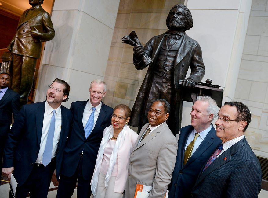 Washington, D.C. Councilmembers David Grosso (D-At Large), left, Jack Evans (D-Ward 2), second from left, Vincent Orange (D-At Large), third from right, Tommy Wells (D-Ward 6), second from right, Congresswoman Eleanor Holmes Norton (D-D.C.), third from left, and Mayor Vincent Gray, right, pose for a photograph together after a congressional ceremony to commemorate the dedication and unveiling of a statue of Frederick Douglass in Emancipation Hall of the the United States Visitors Center, Washington, D.C., Wednesday, June 19, 2013. (Andrew Harnik/The Washington Times)