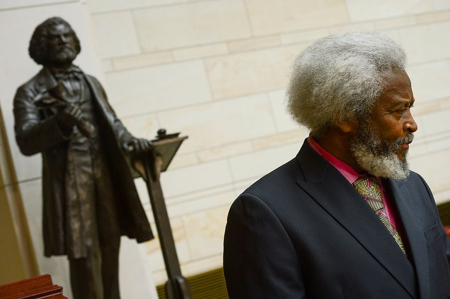 Michael E. Crutcher, Sr. of Historical Presentations and an impersonator of Fredrick Douglass stands near a statue of Frederick Douglass before a congressional ceremony to commemorate the dedication and unveiling of the statue in Emancipation Hall of the the United States Visitors Center, Washington, D.C., Wednesday, June 19, 2013. (Andrew Harnik/The Washington Times)