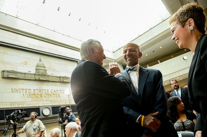 Left to right: Rep. Steny Hoyer (D-Md.) and former Washington, D.C. mayors Anthony Williams and Sharon Pratt Kelly chat together before a congressional ceremony to commemorate the dedication and unveiling of a statue of Frederick Douglass in Emancipation Hall of the the United States Visitors Center, Washington, D.C., Wednesday, June 19, 2013. (Andrew Harnik/The Washington Times)