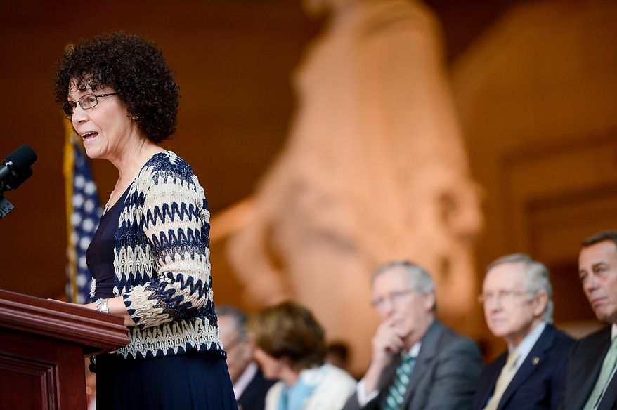 Nettie Washington Douglass, Frederick Douglass' great great granddaughter, left, speaks at a congressional ceremony to commemorate the dedication and unveiling of a statue of Frederick Douglass in Emancipation Hall of the the United States Visitors Center, Washington, D.C., Wednesday, June 19, 2013. (Andrew Harnik/The Washington Times)
