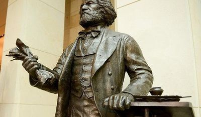 The statue of Frederick Douglass stands in Emancipation Hall before a congressional ceremony to commemorate the dedication and unveiling of the statue at the United States Visitors Center, Washington, D.C., Wednesday, June 19, 2013. (Andrew Harnik/The Washington Times)