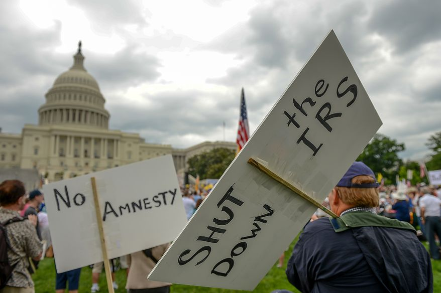 """Tea party members gather for a rally against the Internal Revenue Service entitled, """"Audit the IRS"""" on the West Lawn of the U.S. Capitol Building, Washington, D.C., Wednesday, June 19, 2013. (Andrew Harnik/The Washington Times)"""
