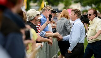 ** FILE ** Sen. Rand Paul (R-Ky.) greets supporters after speaking at a tea party rally on the West Lawn of the U.S. Capitol Building, Washington, D.C., Wednesday, June 19, 2013. (Andrew Harnik/The Washington Times)