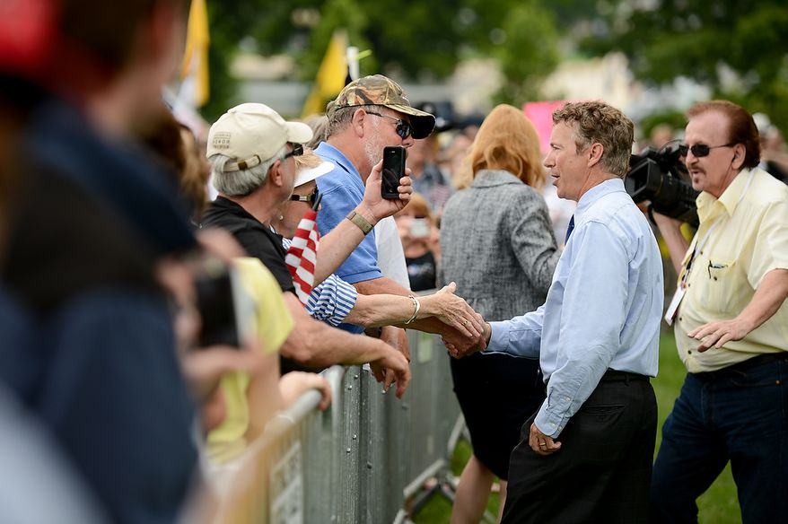 """Sen. Rand Paul (R-Ky.) greets supporters after speaking at a tea party rally against the Internal Revenue Service entitled, """"Audit the IRS"""" on the West Lawn of the U.S. Capitol Building, Washington, D.C., Wednesday, June 19, 2013. (Andrew Harnik/The Washington Times)"""