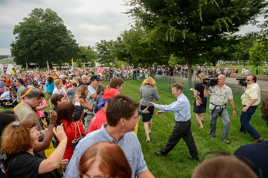 "Sen. Rand Paul (R-Ky.) greets supporters after speaking at a tea party rally against the Internal Revenue Service entitled, ""Audit the IRS"" on the West Lawn of the U.S. Capitol Building, Washington, D.C., Wednesday, June 19, 2013. (Andrew Harnik/The Washington Times)"