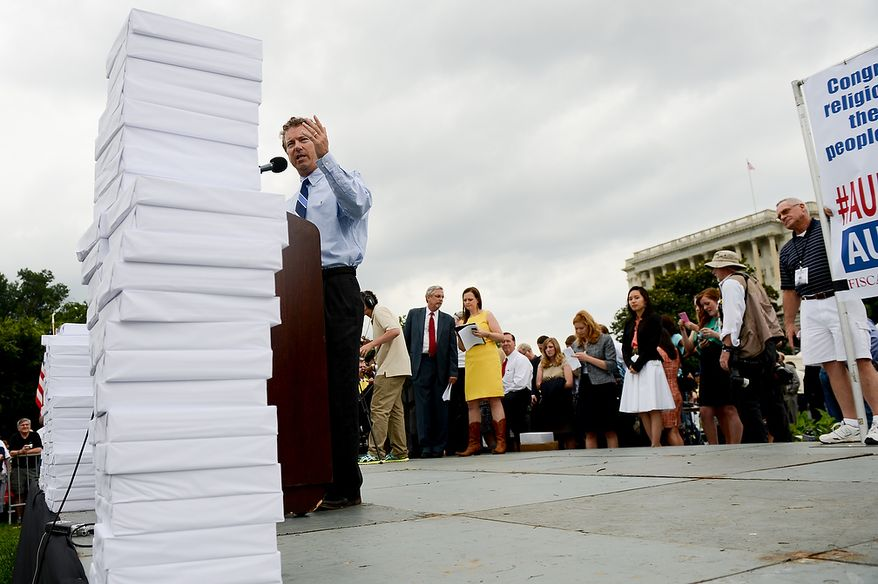 """Sen. Rand Paul (R-Ky.) speaks at a tea party rally against the Internal Revenue Service entitled, """"Audit the IRS"""" on the West Lawn of the U.S. Capitol Building, Washington, D.C., Wednesday, June 19, 2013. (Andrew Harnik/The Washington Times)"""