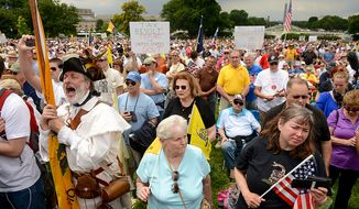 "Tea party supporters listen to speakers at a rally against the Internal Revenue Service entitled, ""Audit the IRS"" on the West Lawn of the U.S. Capitol Building, Washington, D.C., Wednesday, June 19, 2013. (Andrew Harnik/The Washington Times)"