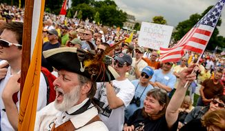 """William Temple, left, dressed in a tri-corner hat, cheers for speakers at a tea party rally against the Internal Revenue Service entitled, """"Audit the IRS"""" on the West Lawn of the U.S. Capitol Building, Washington, D.C., Wednesday, June 19, 2013. (Andrew Harnik/The Washington Times)"""