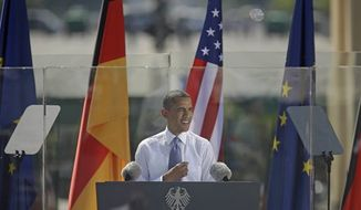 """President Barack Obama speaks in front of the iconic Brandenburg Gate in Berlin Germany, Wednesday, June 19, 2013. Obama spoke on the Gate's eastern side, across the old border from where President Ronald Reagan gave his unforgettable """"Mr. Gorbachev, tear down this Wall!"""" speech in June 1997. This week also marks the 50th anniversary that President John F. Kennedy confronted Cold War tension in Wall-divided Berlin by telling residents, """"Ich bein ein Berliner."""" (AP Photo/Pablo Martinez Monsivais)"""