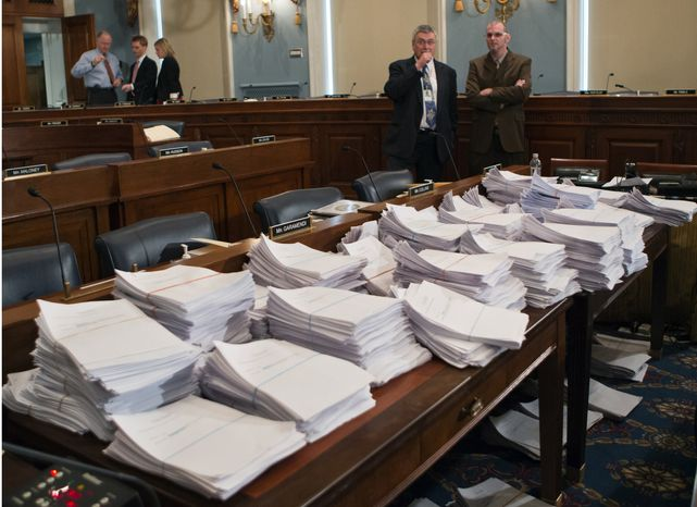 **FILE** Stacks of paperwork await members of the House Agriculture Committee on Capitol Hill in Washington on May 15, 2013, as it meets to consider proposals to the 2013 Farm Bill. (Associated Press)