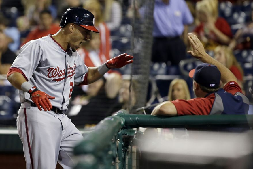 Ian Desmond's 11th-inning grand slam lifted the Nationals over the Phillies. (Associated Press photo)