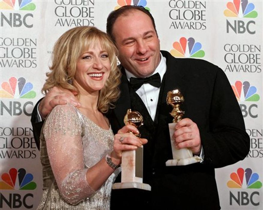 """** FILE ** Edie Falco, left, and James Gandolfini with their awards for best performance by an actress and actor in a dramatic televison series for """"The Sopranos,"""" during the 57th Golden Globe Awards in Beverly Hills, Calif., July 23, 2000. (Associated Press)"""