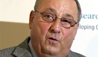 FILE - In this April 19, 2013 file photo, Gov. Paul LePage speaks at a news conference at the State House in Augusta, Maine. LePage used a sexually vulgar phrase Thursday, June 20, 2013, to describe how Democrat state Sen. Troy Jackson is taking advantage of the people. LePage's comment came as he has said he intends to veto a two-year budget because it includes tax increases. (AP Photo/Robert F. Bukaty, File)