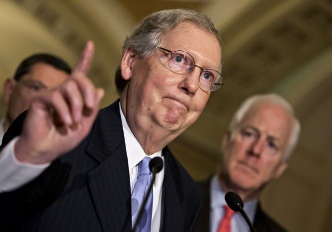 **FILE** Senate Minority Leader Mitch McConnell, Kentucky Republican, accompanied by Senate Minority Whip John Cornyn (right), Texas Republican, and Sen. John Barrasso, Wyoming Republican, speaks with reporters on Capitol Hill in Washington on June 18, 2013. (Associated Press)