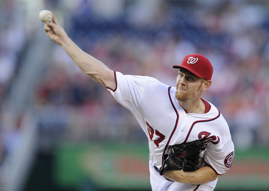Stephen Strasburg delivers a pitch in Friday night's 2-1 Nationals victory over the Colorado Rockies. (Associated Press photo)
