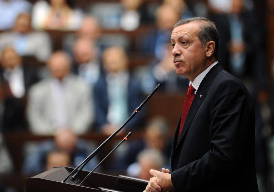 ** FILE ** Turkey's Prime Minister Recep Tayyip Erdogan addresses his lawmakers at parliament, in Ankara, Turkey, Tuesday, June 18, 2013. (AP Photo)