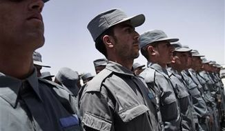 Afghan soldiers attend a transfer of authority ceremony of the police academy from NATO-led troops to Afghan security forces in Kabul, Afghanistan, Saturday, June 22, 2013. (AP Photo/Rahmat Gul)