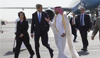 U.S. Ambassador to Qatar Susan Ziadeh, left, walks with U.S. Secretary of State John Kerry, second from left, and Ambassador Ibrahim Fakhroo, Qatari Chief of Protocol, on Kerry's arrival in Doha, Qatar, on Saturday, June 22, 2013. (Associated Press)