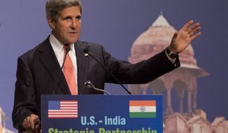 U.S. Secretary of State John F. Kerry makes a speech in part about climate change at the India Habitat Center in New Delhi on Sunday, June 23, 2013, on his first visit to India as the top U.S. diplomat. (AP Photo/Jacquelyn Martin, Pool)
