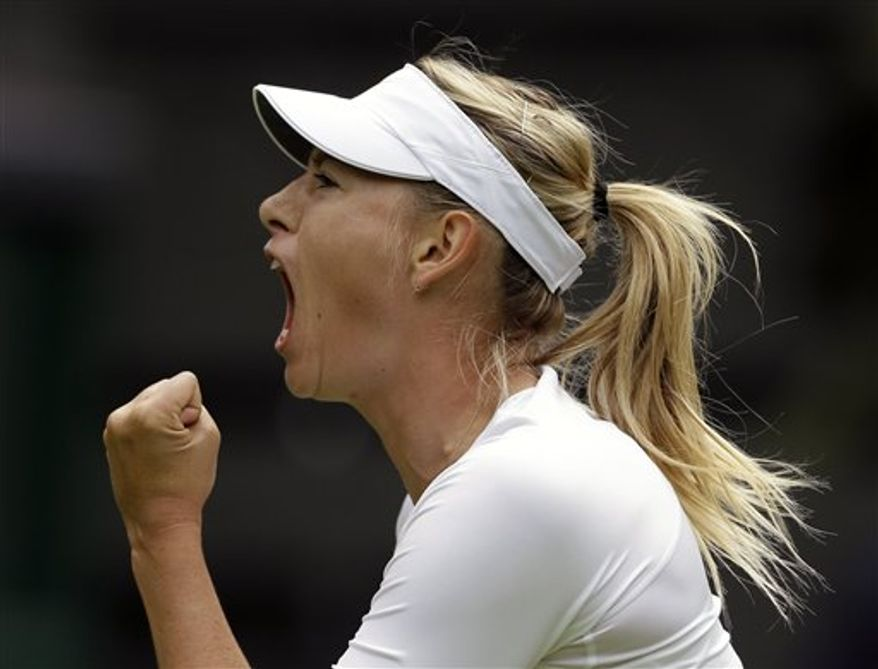 Maria Sharapova of Russia reacts after winning the first set against Kristina Mladenovic of France during their Women's first round singles match at the All England Lawn Tennis Championships in Wimbledon, London, Monday, June 24, 2013. (AP Photo/Anja Niedringhaus)