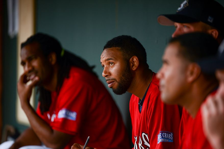 Blue Crabs pitcher Daryl Thompson (3) sits in the dugout as the independent baseball league's Blue Crabs play the Camden RiverSharks at Regency Furniture Stadium, Waldorf, Md., Sunday, June 23, 2013. (Andrew Harnik/The Washington Times)