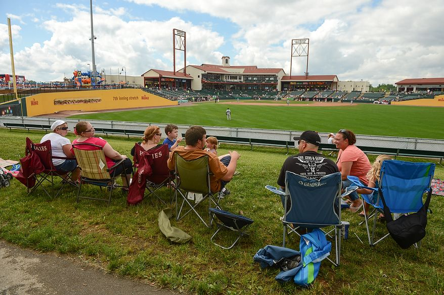 Fans hang out in the outfield as the independent baseball league's Blue Crabs play the Camden RiverSharks at Regency Furniture Stadium, Waldorf, Md., Sunday, June 23, 2013. (Andrew Harnik/The Washington Times)