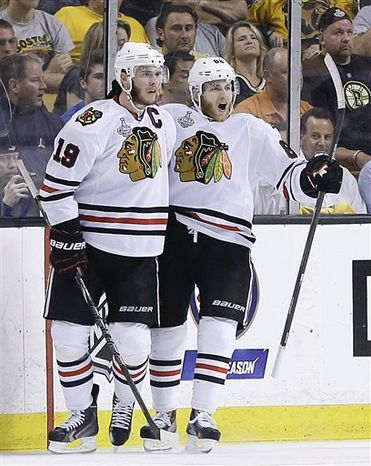 Chicago Blackhawks center Jonathan Toews (19) celebrates his goal with right wing Patrick Kane (88) during the second period in Game 6 of the NHL hockey Stanley Cup Finals against the Boston Bruins, Monday, June 24, 2013, in Boston. (AP Photo/Elise Amendola)