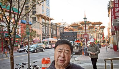 Tony Cheng, president of Tony Cheng's restaurant in Chinatown, and his son were indicted Tuesday on charges of passing a bribe to the head of the D.C. Taxicab Commission in a scheme to circumvent the city's moratorium on new cab companies.