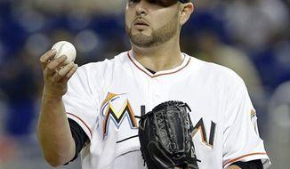 **FILE** Miami Marlins' Ricky Nolasco checks out the ball during a baseball game Monday, June 10, 2013 in Miami. (AP Photo/Alan Diaz)