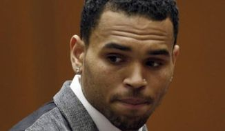 Chris Brown sitting in a Los Angeles courtroom, Sept. 25, 2012. (Associated Press)