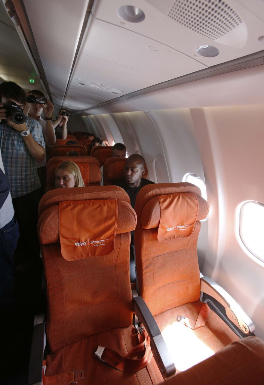 Photographers take pictures as light shines through a cabin window on seat 17A, the empty seat that an Aeroflot official said was booked in the name of former CIA technician and National Security Agency leaker Edward Snowden, during Aeroflot flight SU150 from Moscow to Havana on June 24, 2013. Confusion over the whereabouts of Snowden grew after the flight flew from Moscow to Cuba with the seat remaining empty. (Associated Press)