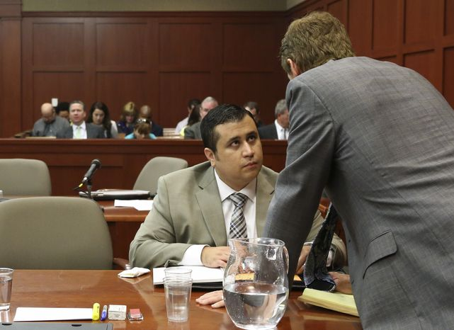 George Zimmerman (left) talks with defense attorney Mark O'Mara during the former's trial in Seminole Circuit Court in Sanford, Fla., on Tuesday, June 25, 2013. Mr. Zimmerman has been charged with second-degree murder in the 2012 shooting death of Trayvon Martin. (Gary W. Green/Orlando Sentinel)